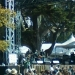 Zoomed in on Earl Scruggs, he\'s the 86 year old man sitting in the chair on the left side of the stage.