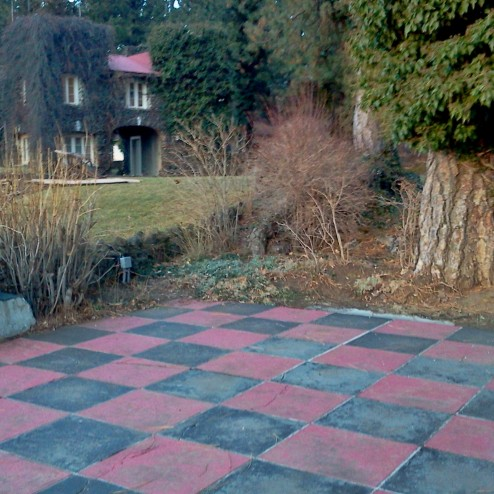 Mr Riblet installed a life-size checkerboard in front of his office turrets. What have you done with your yard recently?